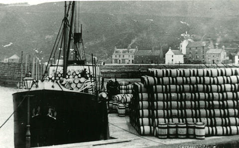 Barrels stacked up at the harbour