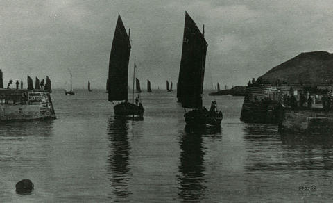 Sailing boats leaving the harbour. Downies Point is in the far right.