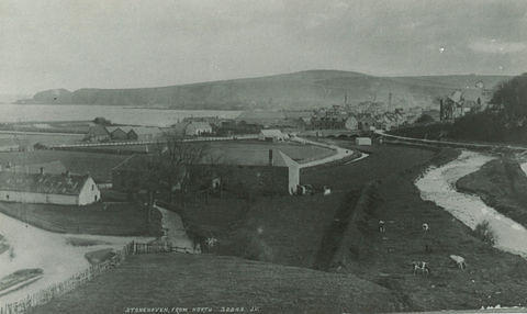 A view of Stonehaven from Glenury with the grain mill in the foreground and recreation grounds beyond. Belmont house can be seen on the right hand side and Bervie Braes in the distance.
