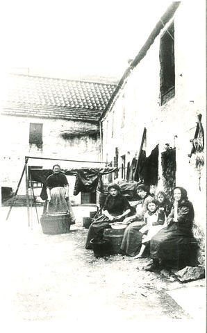 Women & children shelling mussels in the Old Town