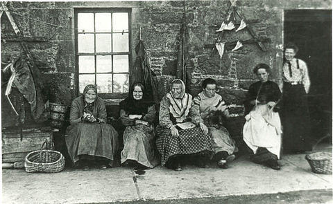 Time for a natter - Women sitting outside their houses in the Old Town.