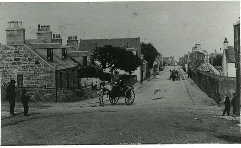 Looking east along Evan Street toward the sea. St. John's Church is on the left hand side and Keith Lodge on the right.