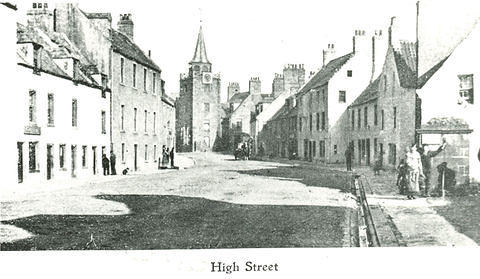A view down the High Street with Cheekers' Well on the right
