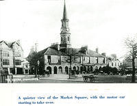 A quiet Market Square with carts and cars