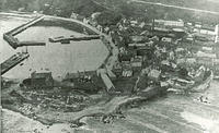 An aerial view of Stonehaven harbour and old town with the Tolbooth on the left