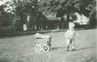 A child playing near a big house