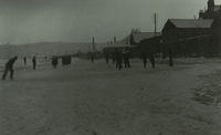 Men playing in the snow on the beach