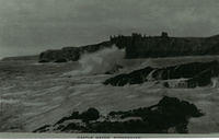 Stormy seas at Castle Haven with Dunnottar Castle in the background