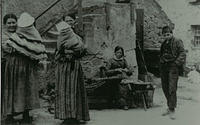 Women with their children in the Old Town.