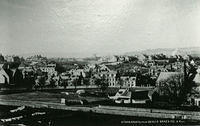 A view of Stonehaven from Bervie Braes towards Cameron Street with the Old Mill, Old Mill Inn and St. James Episcopal Church on the right, the South Church on the left and Fetteresso Church in the distance in the middle.
