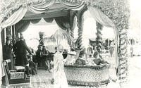 Queen Victoria sitting at a table -