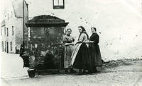 Women at Cheeker's Well in the High Street of the Old Town