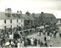 Crowds at the harbour listen to Queen Elizabeth the Queen Mother at the opening of the Tolbooth in 1963