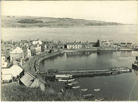 Stonehaven Harbour from Bervie Braes looking towards Megray Hill and showing the Tolbooth in ruins