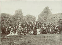 A large group photograph including military bandsmen and maids ? taken at Dunnottar Castle
