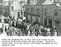 Peace Day Celebrations in Evan Street in 1919. Mitchell's Grocer Shop is on the corner with Barclay Street.