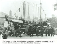 "The crew of the Stonehaven Lifeboat ""Joseph Ridgeway"" on a horse drawn carriage in the Market Square"